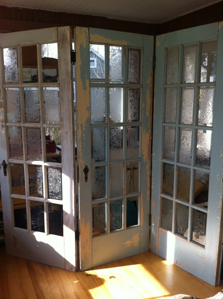 Antique doors in the garden artisan upholstery studio for Do french doors have screens